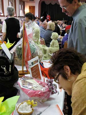 A silent auction featuring more than 30 items garnered the intent attention of many of those attending Sunday's spaghetti dinner.