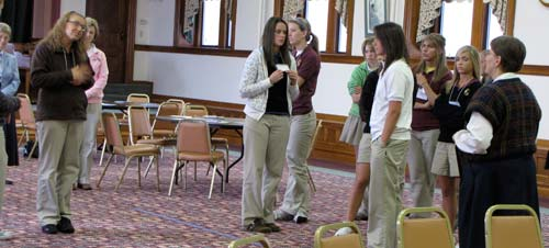 Ashley Laas, left, explains why she moved from the agree side to the disagree side in an exercise about when forgiveness is possible, as part of a March 26 retreat.