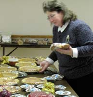 Glenda Schreiber checks out whats available at this morning's bake sale.
