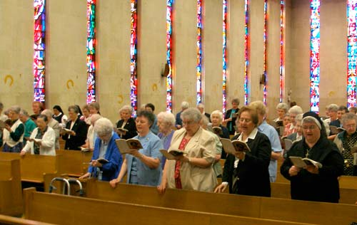 Sisters sig the entrance hymn at the Mass in their honor on May 13 in Sacred Heart Cathedral in Salina.