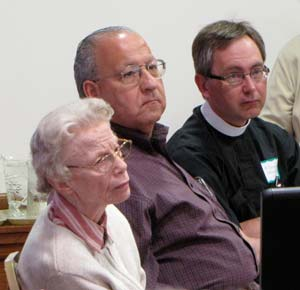 Sister Miriam Vaughan and Pastors L. Dean Thompson, center, and David Strommen listen to the presentation Thursday morning. About 40 sisters and local clergy attended.