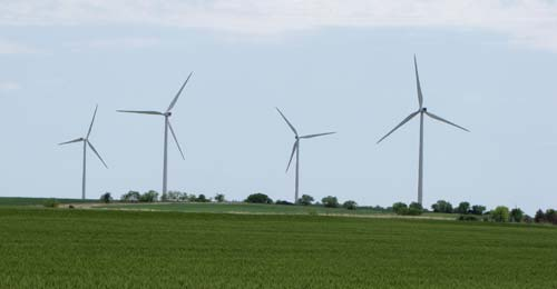 A total of 67 wind turbines dot the wheat fields on both sides of Highway 81 south of Concordia.