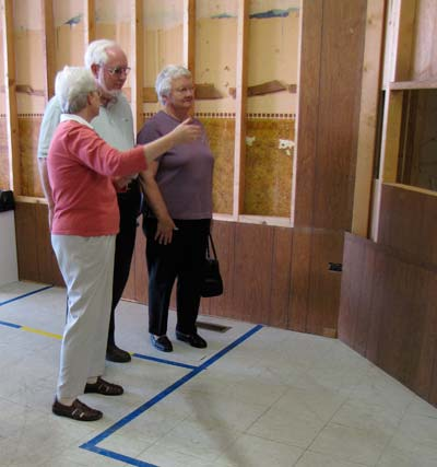 Sister Pat McLennon, left, gives Bob and Lorene Steimel a tour through what will be the new Neighbor to Neighbor center during Thursday afternoon\s party. Bob Steimel, president of the Community Foundation of Cloud County presented a $2,500 to the sisters for renovating the downtown Concordia building.
