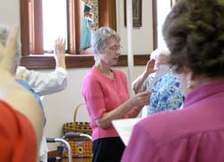 Sisters of St. Joseph of Concordia surround Sister Marcia Allen with prayer during a June 2006 meeting at the Motherhouse.