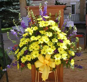 A summer bouquet decorates the outside altar.