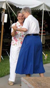 Sister Carm Thibault finds a partner to join the polka crowd.