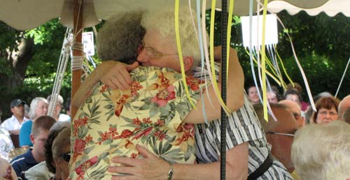 Sisters Clarene Kennedy and Mary Jo Thummel hug after Sister Mary Jo is honored as a jubilarian.