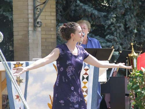 Laurie Kertz dances to Love Changes Everything during the jubilee celebration.