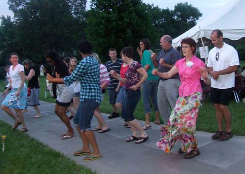 As dusk fell, more dancers crowded the impromptu stage in front of the Motherhouse.