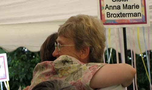 Sisters Jean Rosemarynoski and Anna Marie Broxterman hug after Anna Marie was honored.