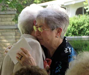 Sister Pat McLennon gets a hug from Sister Sylvia Winterscheidt after Sister Pat is honored as a jubilarian.