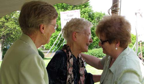 Sister Redempta Eilert receives a hug as part of being honored as a jubilarian.