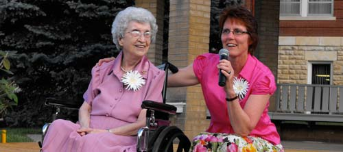 Sisters Susan Kongs, celebrating 70 years in the order, and Sister Christy Cogil, celebrating 25 years, share the stage during the after-dinner festivities.