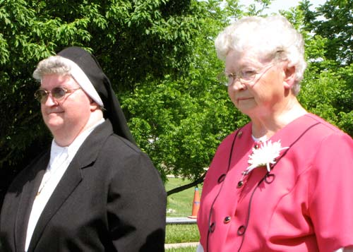 Sisters Veronica Baxa and Mary Augistine proceed to the ceremony and Mass.