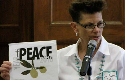 During Wednesdays forum at the Motherhouse, Sue Sutton of Cloud County Community College shows a draft design of a logo for the Concordia Year of Peace.