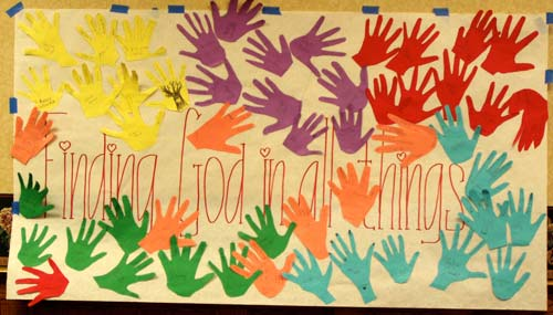 The theme of this years camp was Finding God in All Things, and one of the girls first task was to create their banner.