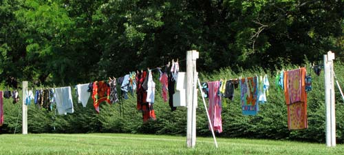 The girls swimsuits and towels add a bright accent on the grounds south of the greenhouse.