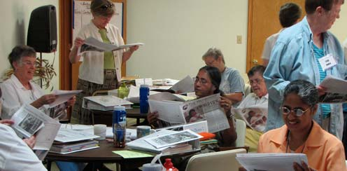 Before the days session begins, participants spend a few minutes with the Concordia congregations quarterly newspaper, The Messenger.