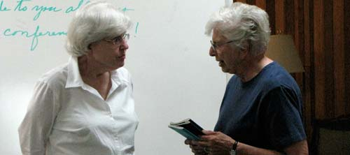 Sisters Pat Bryne, left, and Carolyn Teter of the Concordia congregation chat during a break between lectures.