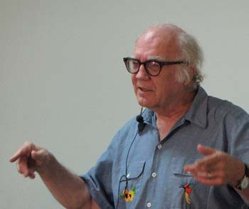 Jim Douglass, shown lecturing on Friday, has written four books on the theology of nonviolence.