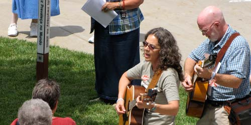 Salina musicians and peace activists Janie Stein, left, and Marty Bates perform during Thursdays prayer vigil at the Motherhouse in Concordia.