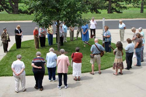 Sister Regina Ann Brummel stands next to the Peace Pole near the main entrance of the Sisters of St. Joseph Motherhouse in Concordia as she leads the prayer vigil Thursday afternoon. The ceremony marked the 64th anniversary of the atomic bombing of Hiroshima, Japan.