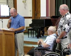 Jeff Koch speaks on behalf of Herman J. Koch, seated at right, and other family members accepting their award Sunday.