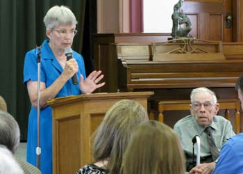 Sister Lucy Schneider speaks on behalf of the John J. Schneider family, which farms land west of Salina, as her brother, John J. Jr., looks on.