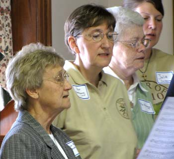 (Bottom to top) Sisters Anna Marie Broxterman, Jean Rosemarynoski, Pat McLennon and Julie Christensen join other singers for one of two songs written especially for the Concordia Year of Peace.