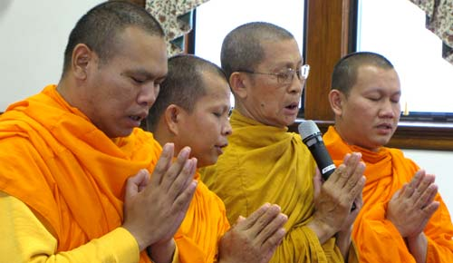 The four monks from the Buddhist Temple of Kansas in Salina chant a special peace prayer during their part of Sundays ceremony.