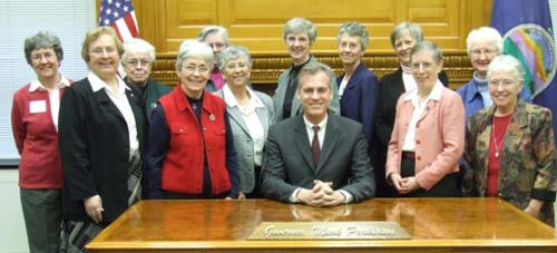 The sisters meeting with Gov. Mark Parkinson Wednesday: (Front row, from left) Beth Stover, Sue Miller, Esther Pineda, Parkinson, Therese Bangert, Tarcisia Roths; (back row, from left) Barbara McCraken, Christina Meyer, Nancy Bauman, Linda Roth, Judy Stephens, Maureen Hall and Mary Ellen Loch.