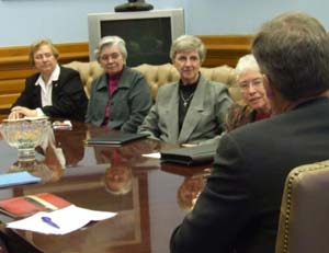 (From left) Sisters Beth Stover, Nancy Bauman, Linda Roth and Tarcisia Roth question Gov. Mark Parkinson on a wide range of issues in a meeting at the Capitol Wednesday.
