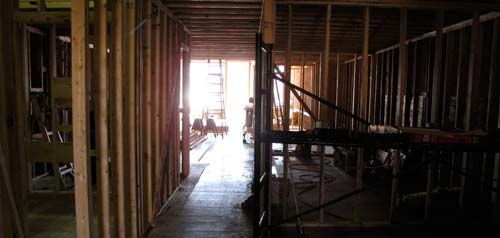 The skeleton of interior walls begin define the playrooms, meeting space, kitchen and other rooms in the first floor of the new center.