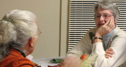 Longtime CSJ Associate Oralia C. Rede, left, chats with congregational president Sister Marcia Allen before the associates commitment ceremony at St. Marys Spirituality Center in Silver City Oct. 30.
