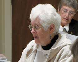 Sisters Rosemary Farrell, foreground, and Rita Plante join in prayer during the associates ceremony Oct. 30.