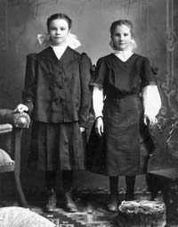 A 1912 photograph shows Genevieve Dreiling (right), who will become Sister Roberta, posing with a cousin in Victoria, Kan.