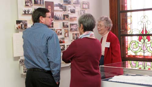 Sister Dorothy Hoover, right, answers questions from Leon and Loleta Deaver about the history of the Sisters of St. Joseph during this afternoons Christmas Open House at the Motherhouse.