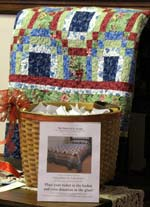 Entries in the drawing for this colorful quilt overflowed the basket before Sister Jane Guenette picked the winner.