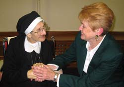 Sharon Hayes, right, chats with Sister Mary Julia Stegeman during the New Years Day reception at the Motherhouse.