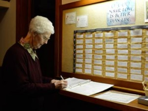 Sister Norma Schlick and others spend part of each day ensuring that the prayer board at the Motherhouse is up to date.