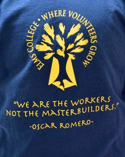 The official Elms College volunteer shirt is emblazoned with a quote from XXXXXXX.