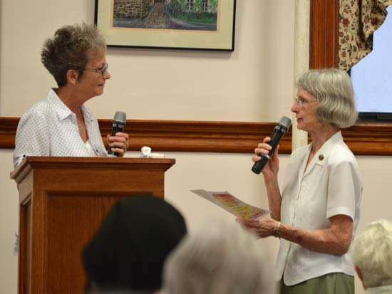 Sister Marcia Allen, right, welcomes Sharon Bolton as a candidate during the June Assembly