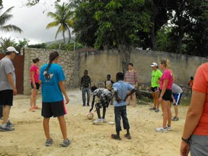 The Haitian children prove to be much better at soccer than the Nebraska volunteers.