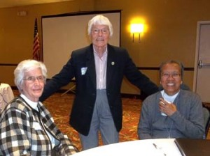 Sister Mary Savoie, left, and Sister Margaret Nacke pose with Sister Estrella Castalone during the U.S. Catholic Sisters Against Human Trafficking meeting in Alexandria, Va., earlier this month.