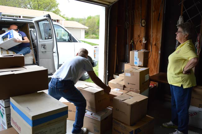 Curtis Mansfield, left, and Keith Sells work at loading all the boxes of shoes Sister Beth Weddle has amassed for the Tree of Life Relief Agency in South Dakota.