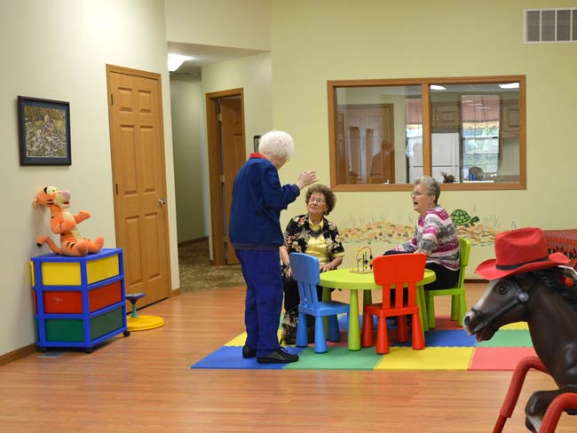 The upstairs playroom is usually reserved for children, but one of the small tables provided a rest stop during a tour of the center Tuesday afternoon.
