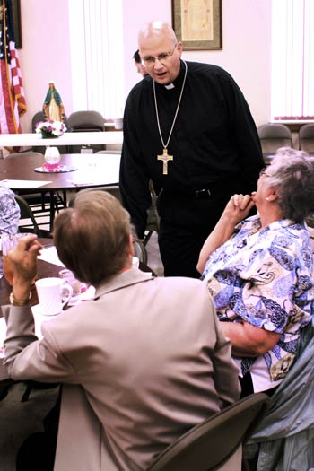 Bishop Edward Weisenburger chats with Sisters Mary Lou Roberts, right, and Therese Blecha during Wednesday's luncheon.