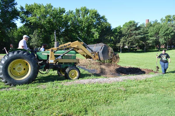 Motherhouse gardener Lyle Pounds lent a hand — and a tractor — to help move mulch to the new pumpkin patch.