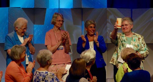 Outgoing LCWR president Sr. Carol Zinn, SSJ, right, acknowledges the applause Friday at the Leadership Conference of Women Religious' annual assembly in Houston. Next to her, from left, are Past-President Sister Sharon Holland, IHM, Sister President Marcia Allen, CSJ, and President-Elect Sister Mary Pellegrino, CSJ. (Global Sisters Report photo / Dan Stockman)