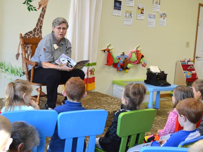 "Connie Palacio, a volunteer for the Sisters of St. Joseph, was the ""guest"" reader at this morning's ""Reading with Friends."""